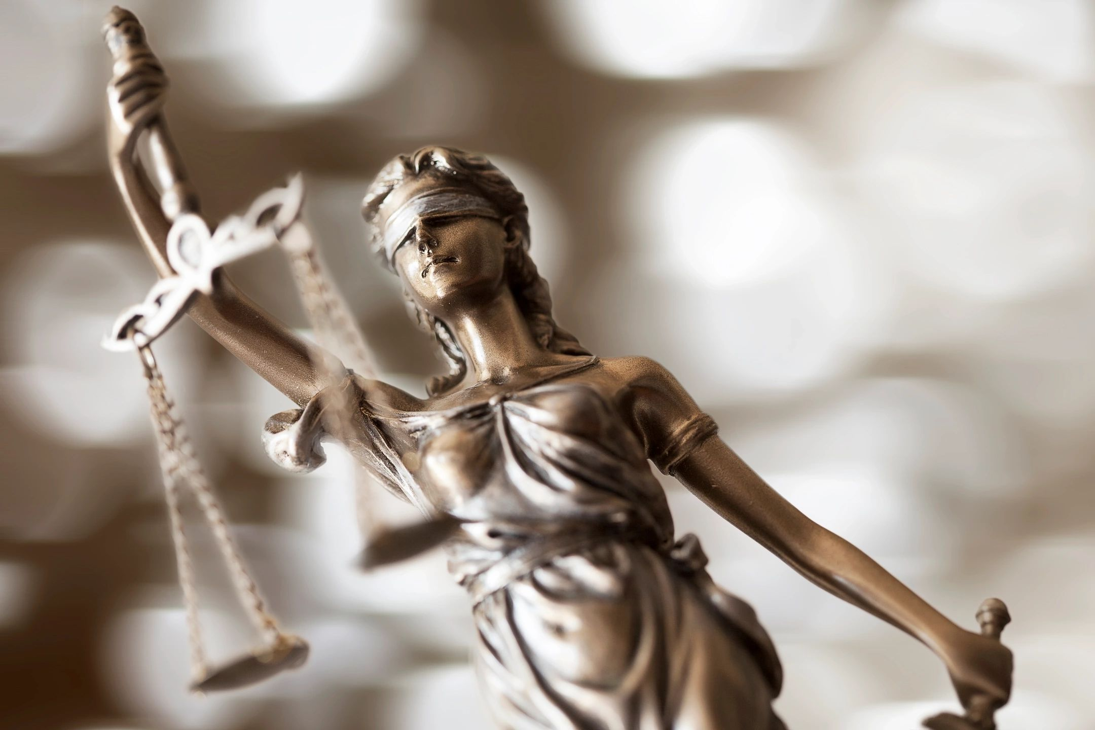 Lady Justice holding scale